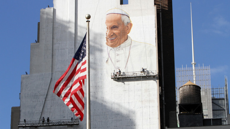 Artists paint an image of Pope Francis on the side of a building in New York City Aug. 27. The mural, which will be 225-feet tall when completed, faces Madison Square Garden, where the pope will celebrate Mass Sept. 25. The artwork was commissioned by DeSales Media Group, the communications and technology arm of the Diocese of Brooklyn, N.Y. (CNS photo | Gregory A. Shemitz)