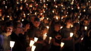 People take part in a candlelit vigil following a mass shooting at Umpqua Community College in Roseburg, Ore., Oct. 1. (CNS photo | Steve Dipaola, Reuters)