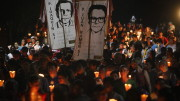 """People participate in the """"little lanterns march"""" at the Central American University in San Salvador during the 2015 commemoration of the 26th anniversary of the massacre of six Jesuit priests and two women, murdered in November 1989 by a military commando. (CNS photo 
